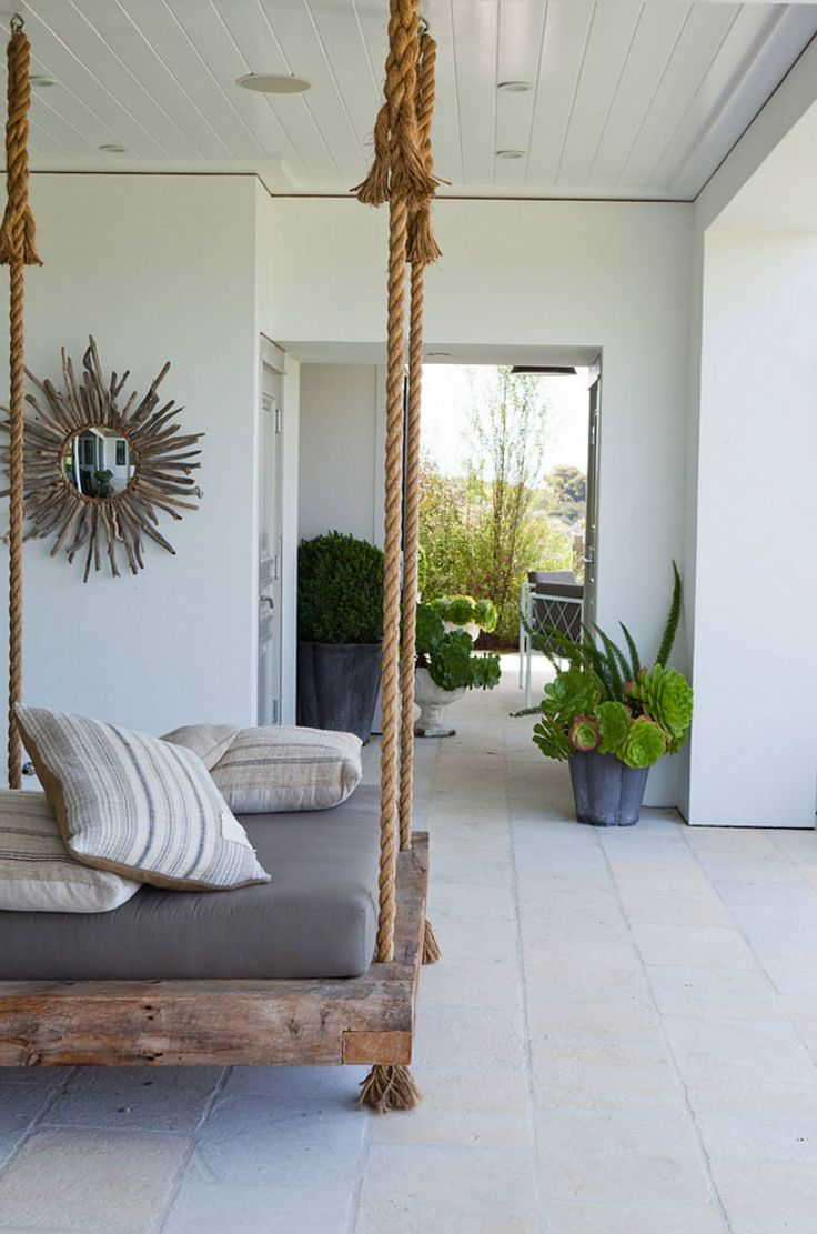 Coastal cottage porch with hanging day bed