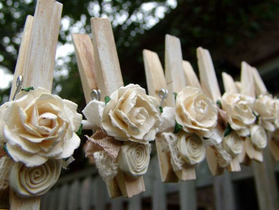 I love how this set turned out! I painted each pin or peg (both sides) with antique white and then gave them a distressed, shabby chic look and added the seam binding, lace and flowers. The flowers are paper flowers, some of which I made. This listing is for a set of 6 clothes pins. The uses for these are endless...I would love to hear what you intend to use them for ;-). Some ideas...place card holders, bunting or banners, hanging photos or cards, favor bags (use clips for tags) and they…