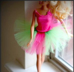 Ballerina Barbie Tulle Tutu! Ponytail holder and strips of tulle make a quick and cheep tutu for barbie!  AllFreeKidsCrafts.com