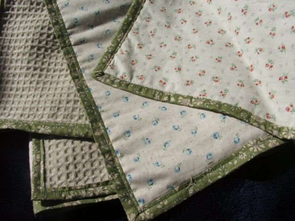 Quilt blanket set for twin boy and girl. 100% cotton. Matching miniature blue/red flower pattern on front with green floral english cotton binding and waffle-weave backing. 2009