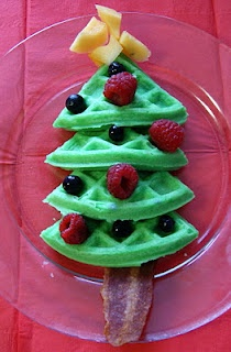 {Christmas Tree Breakfast}... Waffles (green food coloring), bacon for stem, berries for ornaments, canteloupe for star on top