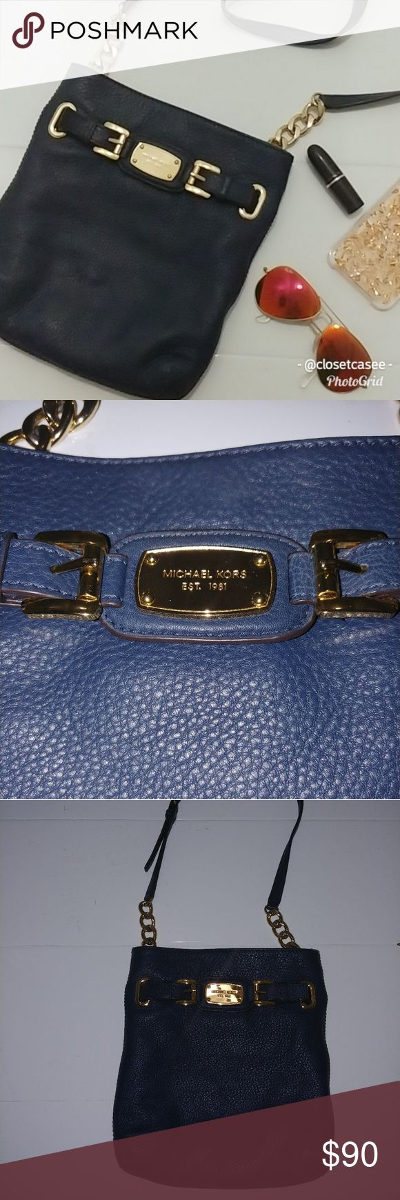 MICHAEL KORS Hamilton Leather Large Crossbody Bag MichaeL KORS Hamilton Leather Large Crossbody Bag *Authentic* Used for about a month, excellent condition! Please see photos for condition.The inside shows some very minor wear, from makeup and such but has be cleaned. Color is dark BLUE  Genuine leather magnetic snap closure Lined interior features zip pocket, 1 open slip pocket Open slip pocket on the back with magnetic snap closure Adjustable leather cross-body strap with gold chain…