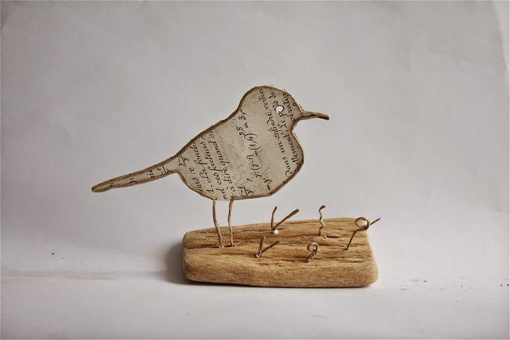 Oiseau en découpe de papier collée sous du kraft armé - création Epistyle