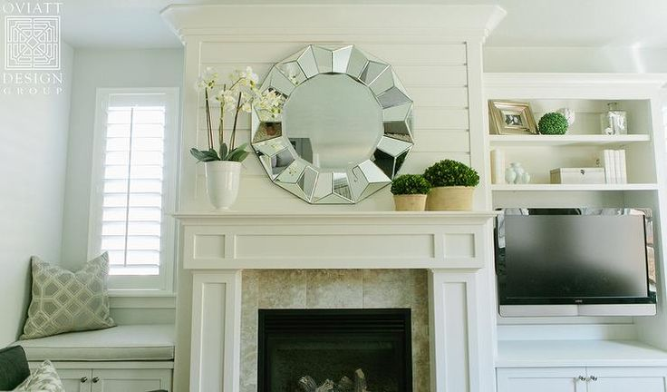 Shiplap Fireplace Flanked by Window Seats, Transitional, Living Room Lovely living room features boasts a white fireplace mantle under a round mirror flanked by a window seat to the left and a media center as well as an additional window seat to the right.