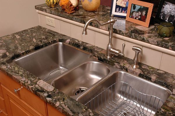 Undermount stainless steel sink with three bowls. Kitchen remodel by Neal's Design Remodel.