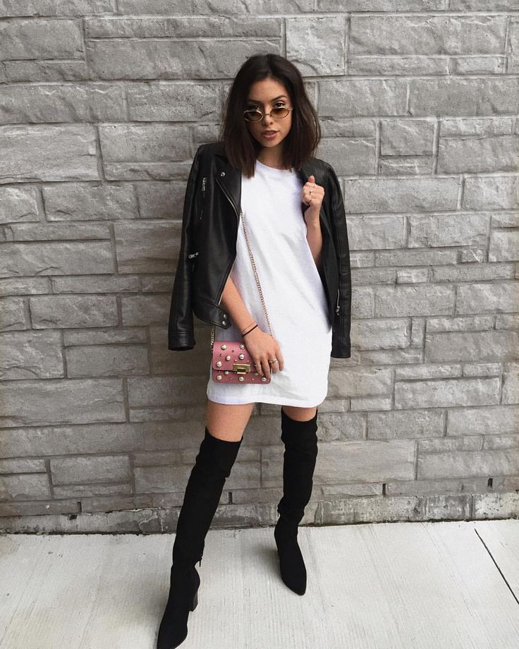 long t-shirt as a dress long over the knees black boots with vintage sunglasses and a touch of pink handbag