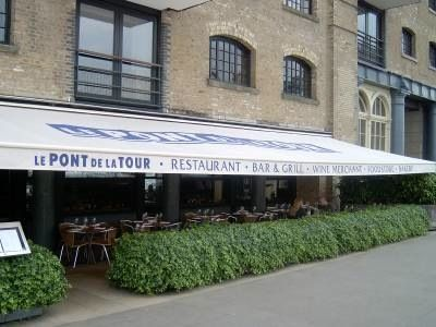 The awning and clearly defined terrace of Pont de la Tour