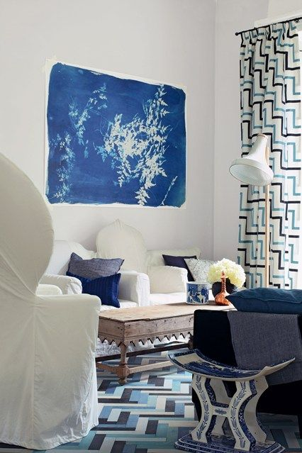 Blue and white geometric pattern on rug and curtains is a great living room design ideas. (houseandgarden.co.uk)
