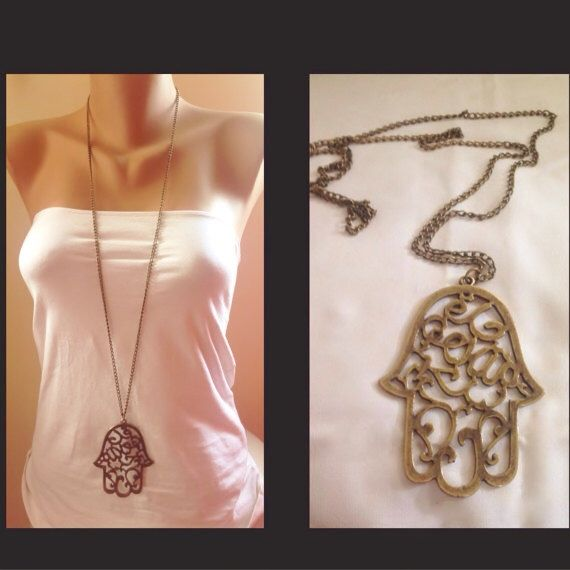 A personal favorite from my Etsy shop https://www.etsy.com/listing/191096209/big-hamsa-hand-necklace-antique-brass