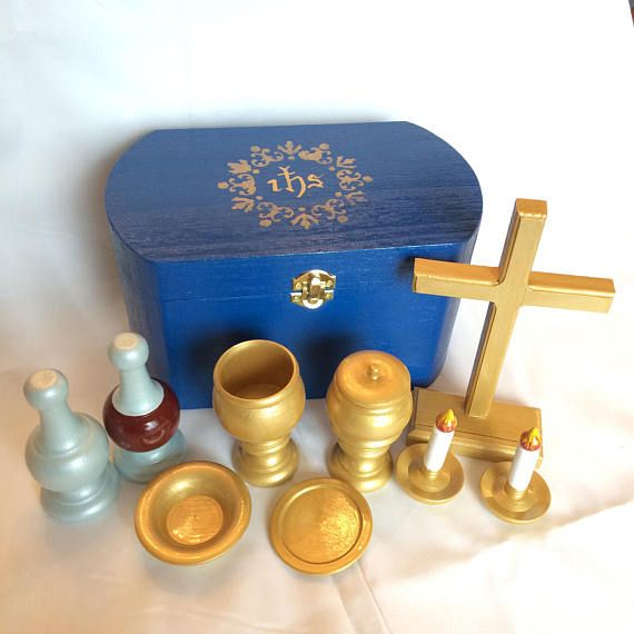 This Deluxe Mass Kit is a terrific way for children to learn about the Liturgy of the Eucharist through exploratory play. Aside from the linens (cotton) and the hosts (felt), all pieces are made of wood, are hand-painted, and are sealed for durability and easy cleanup from sticky fingers. Four colors of altar cloths are included so kids can learn about the liturgical colors used at different times of the year! 22 pieces, including ciborium, chalice, paten, hosts, cross, pretend candles…