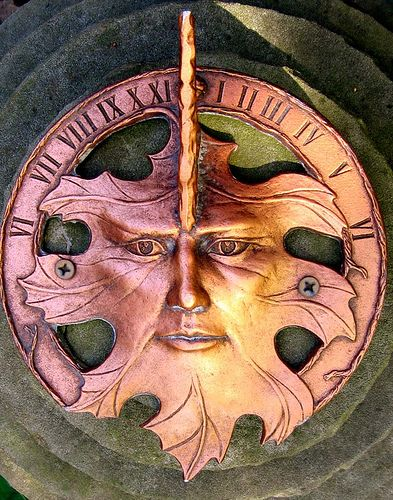 Green man motif handmade copper sundial; great garden accent piece