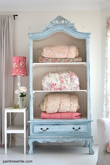 this is a little too feminine for me, but I love the idea of taking the front doors off an old armoire and using it as an open cabinet.