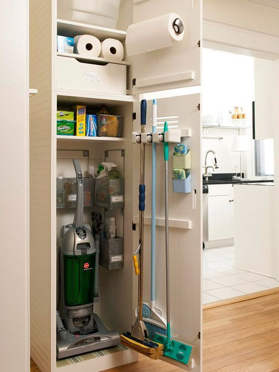 I LOVE ORGANIZATION! !!!!      Cleaning Closet  Finding a place to stow cleaning supplies can be challenging, especially if storage space is limited. Here, a narrow closet nook corrals essential supplies near the kitchen. Small bins organize bottles and brushes, and a door-mounted holder secures taller tools. #closetstorage