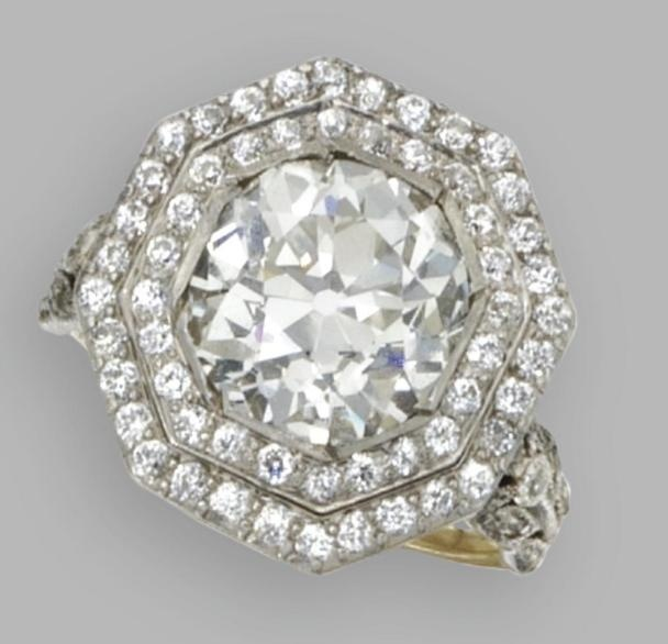 Diamond ring, J.E. Caldwell, Circa 1910. The old European-cut diamond weighing approximately 3.75 carats, framed by smaller old European-cut and single-cut diamonds weighing approximately .60 carat