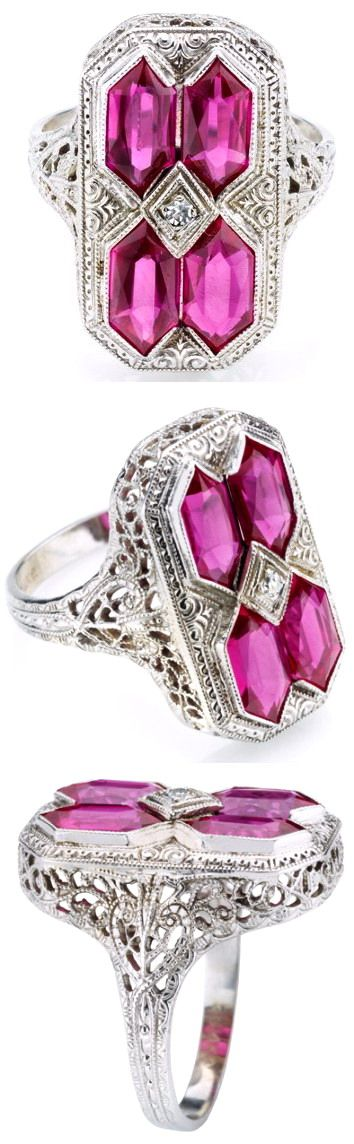 Art Deco Filigree Plaque Ring with Synthetic Rubies. An Art Deco 14K white gold filigree plaque ring set with four elongated hexagonal synthetic rubies, and a small central diamond. Circa 1930.