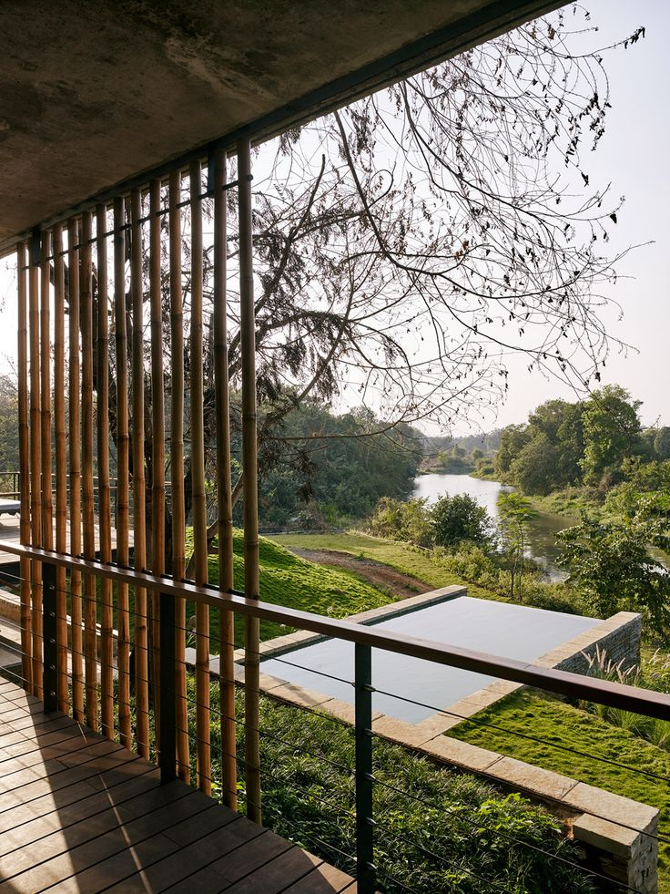 Weekend residence half-embedded in a river bank in India
