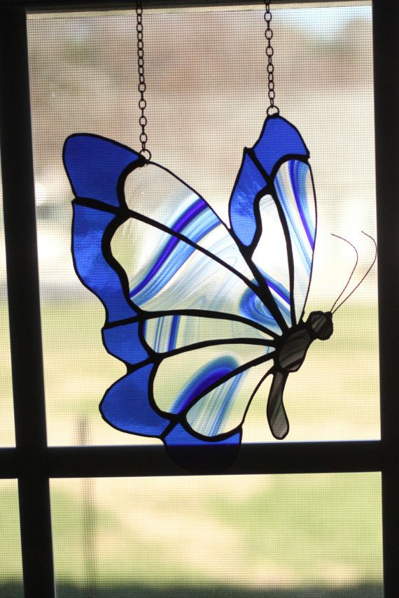 This is a beautiful butterfly piece I made using a cobalt blue glass, a clear glass with cobalt blue veins running through it, accented with black glass. After soldering the pieces together, I put a black patina finish on the solder joints. It measures approximately 9 inches long and 6 inches wide. *most all of my pieces except for any pieces I make as jewelry do contain a percentage of lead