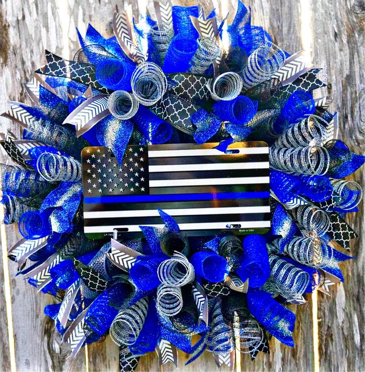 A personal favorite from my Etsy shop https://www.etsy.com/listing/462199918/blue-thin-line-police-wreath-law