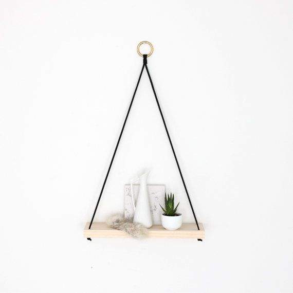 Small design with great impact. This narrow shelf is inspired by the simplicity of minimalist design. Select raw pine, black nylon with solid brass ring