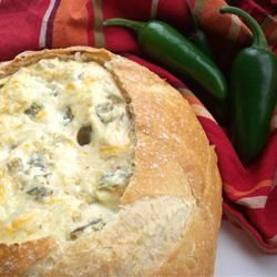 "Insanely Amazing Jalapeno Cheese Dip | ""Jalapenos, Parmesan cheese and Cheddar cheese are baked into a sourdough bread bowl to create this spicy dip."""