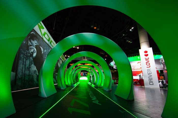 At one entrance, attendees walked down a 51-foot glowing green tunnel, intended to symbolize the distance golfers gain when they...