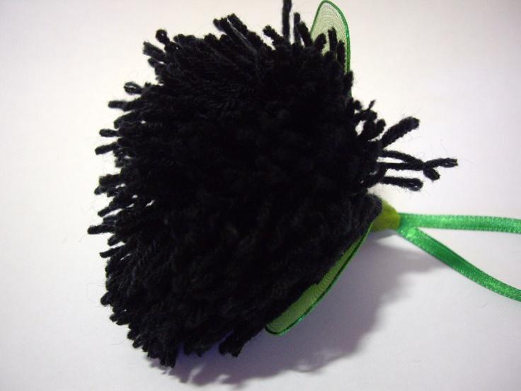 Close up of the black pohutakawa design.
