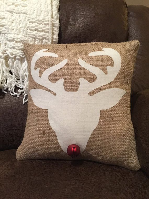 Add some rustic charm to your holiday decor. This reindeer head silhouette burlap pillow is made from recycled burlap and cotton. The applique is hand cut and applied to the pillow. A fun rustic red bell was added for the nose! Accent a bench, your couch or a chair! This pillow cover comes with the pillow insert Sizes available are 14 x 14 or 16 x 16. You may select your size at checkout!    You can view all of my pillows here…