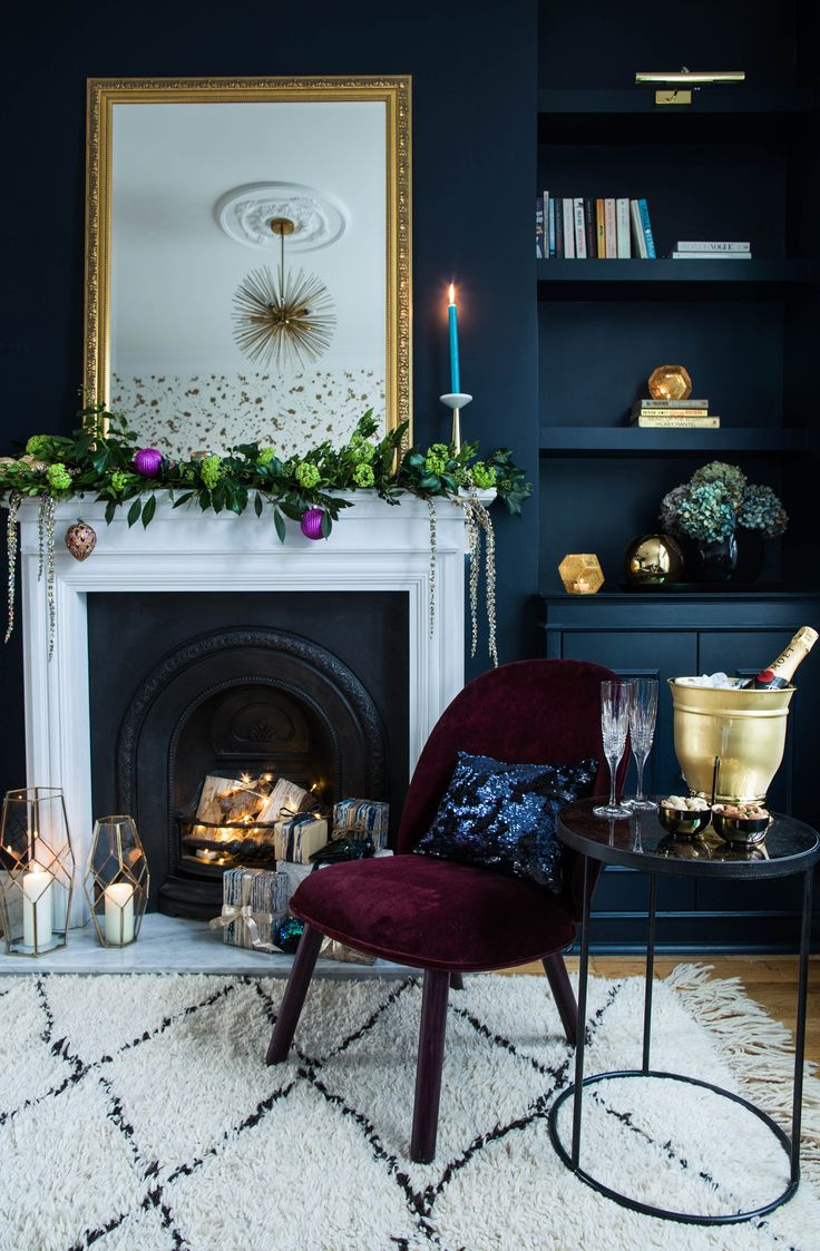 Photo credit - Jane Looker Photography The Gold is a Neutral house goes glam rock for Christmas with Amara. Check out this blogpost for Christmas styling tips and inspiration for your home. Think dark and dramatic walls with rich, indulgent jewel tones, shimmering metallics, oil slick accessories, shimmering sequins, plush velvet and preening peacock feathers combined to create a luxurious festive atmosphere including tips and ideas on how to decorate a fireplace, mantelpiece and staircase.
