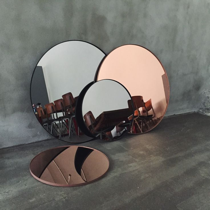 Mirrors in rosey copper and grey. @thecoveteur