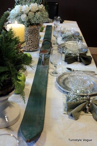 Winter Tablescape: Skis & Greens! I love this. need to get some old wooden skis