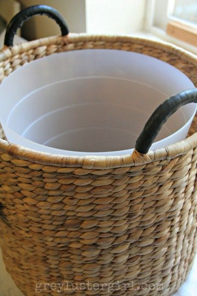 Make your garbage look pretty with a garbage can inside a basket.
