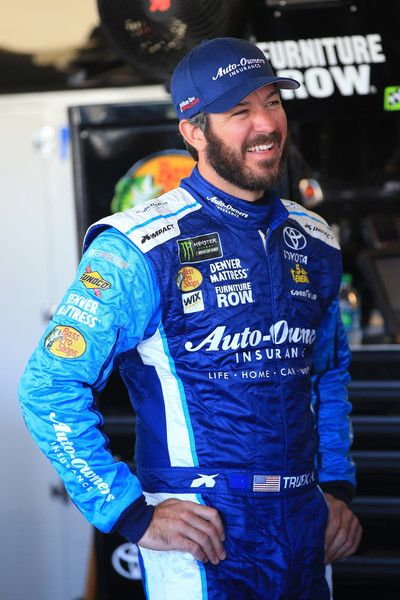 Martin Truex Jr., driver of the #78 Auto-Owners Insurance Toyota, stands in the garage area during practice for the Monster Engergy NASCAR Cup Series Can-Am 500 at Phoenix International Raceway on November 10, 2017 in Avondale, Arizona.