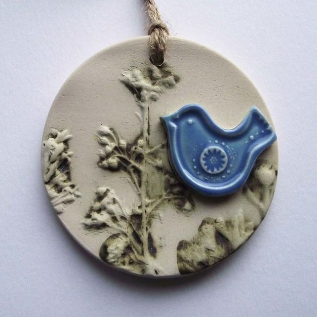 Pottery decoration with natural flower and blue bird decoration. £5.00