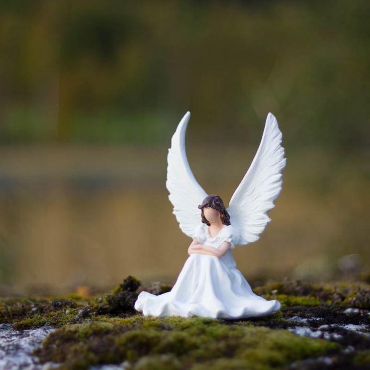 Ängel Astrid sittande
