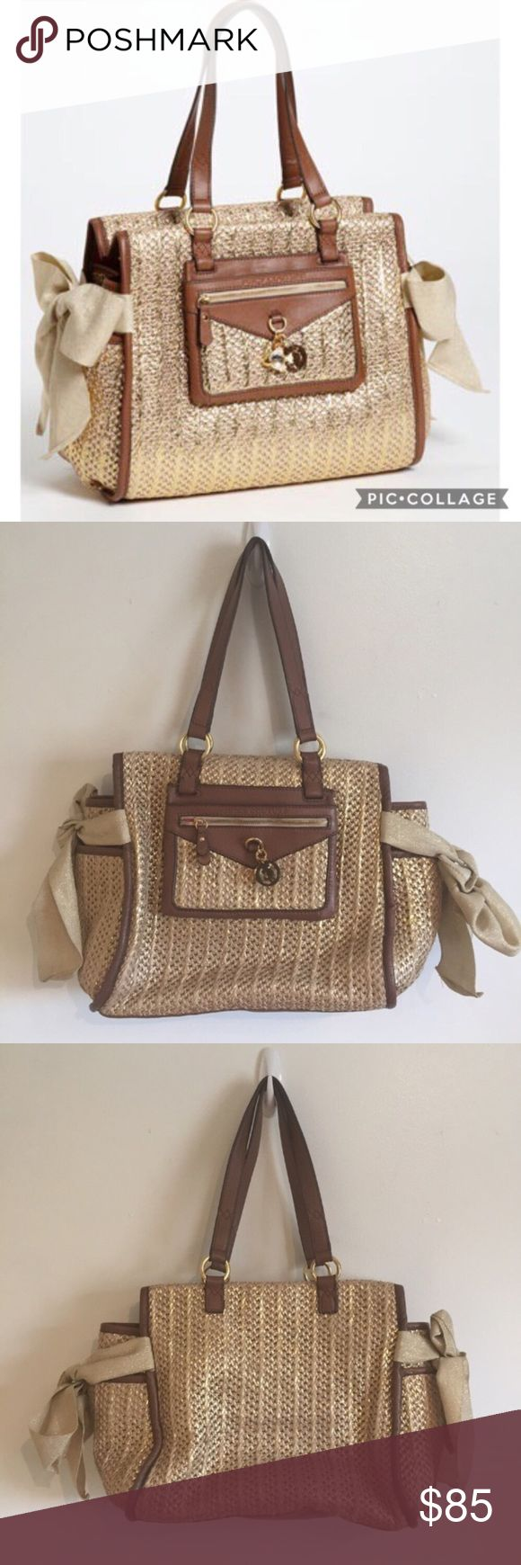 """JUICY COUTURE Dock of The Bay Metallic Straw Purse Juicy Couture """"dock of the bay"""" Metallic daydreamer woven straw wicker jute purse. Has flap Pocket with rhinestone fish charm on front. Inner zipper pocket and cell phone pocket. Zips closed. Does have a few minor fraying/pulled spots as shown in photos. Fun nautical chic vibes. Absolutely perfect for summer vacation! Measures 12"""" Wide at the base (side pockets stick out further) and 11"""" tall. Nice and roomy without being too heavy.  No…"""