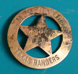Texas Ranger Captain's badge ... found in a garden in Navasota in 1999;  a rare and sought-after collector's item, of historical value, estimated to be worth upwards to a thousand dollars. Not only was it a rare captain's badge, but it had the name of the Ranger Captain right on the front of it, that of M. E. Bailey.  Bailey is known for having once captured four Mexican Revolutionary Generals, all at one time, who were in south Texas recruiting for Pancho Villa.