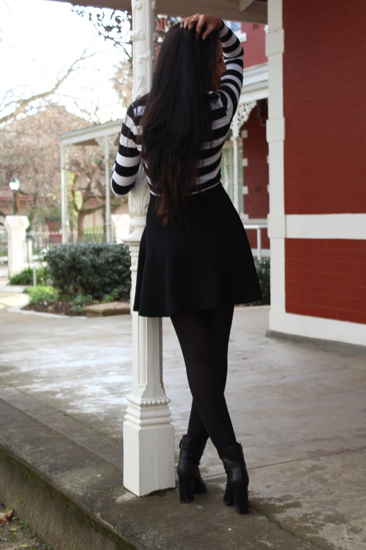 black and white stripe crop top  black skirt black boots
