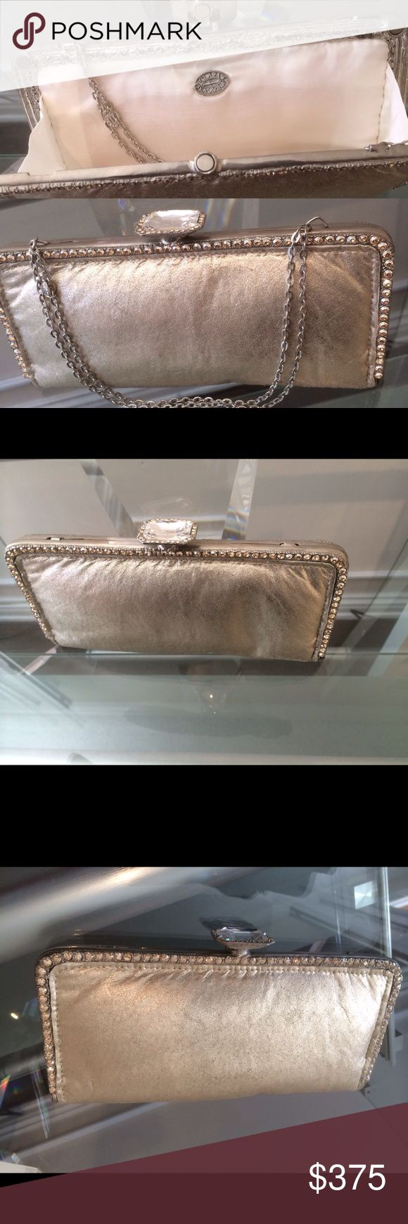 Leather crystal evening bag Exquisite gold lamb leather evening bag adorn with gold crystals can be worn as a clutch or with a chain handle. Designed by  luxury designer Clara Kasavina Clara Kasavina Bags