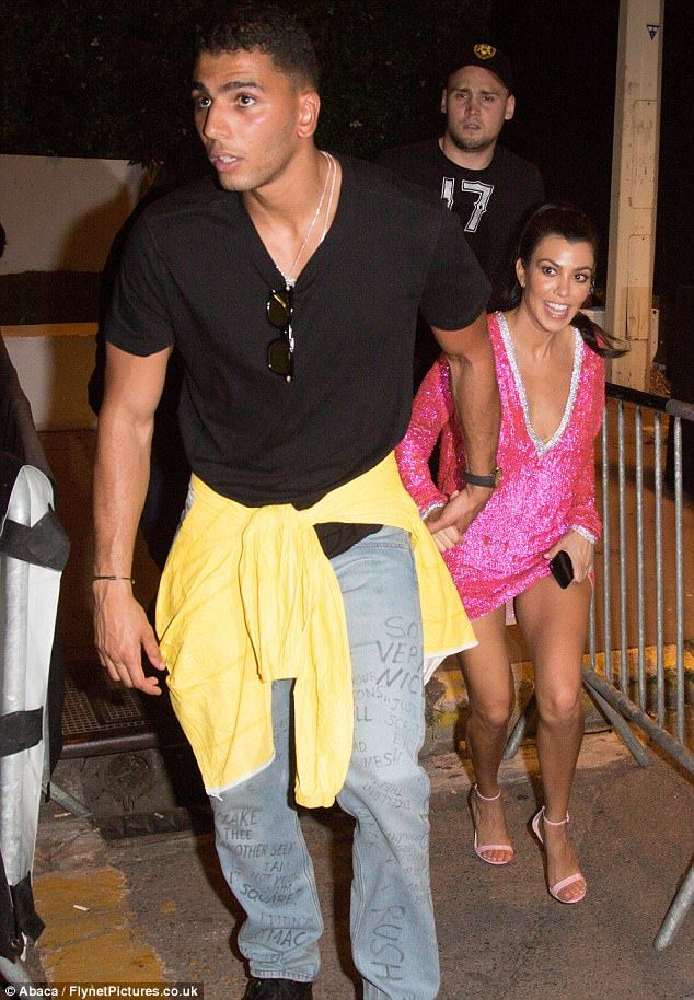 One man and a little lady: Kourtney Kardashian, 38, was positively dwarfed by her toyboy l...