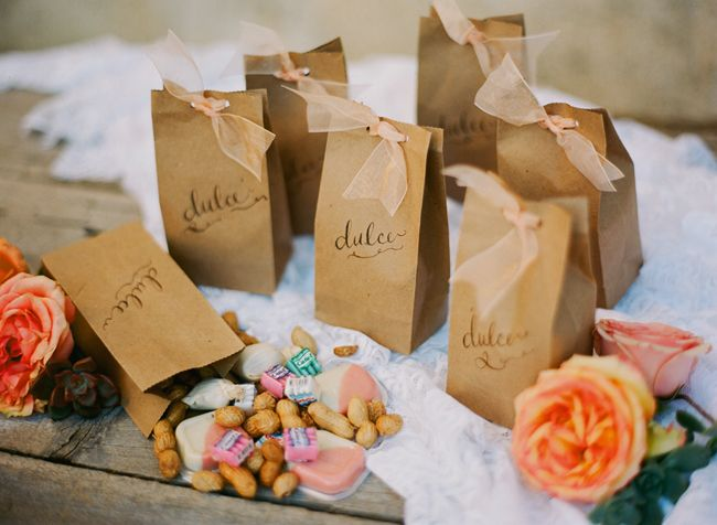Simple kraft bag favors with hole punched ribbon.