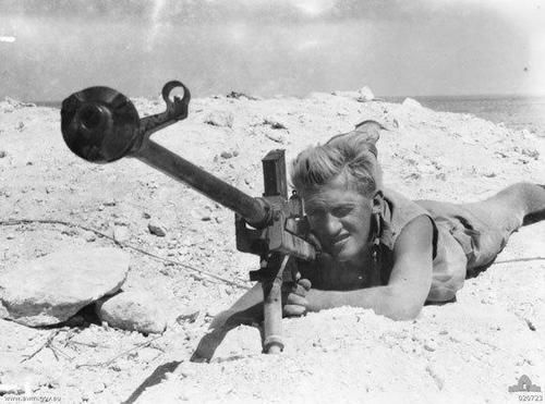 British soldier aiming a Boys anti-tank rifle. Probably North Africa.  Chambered in .55 (or 13.97mm) the Boys anti-tank rifle was approved for service and began production in 1937, run off for six years before becoming obsolete.  It could penetrate, with armor piercing ammunition, 21mm of armor at 330 yards.Yet in those war time years the Boys bolt-action anti-tank rifle saw some use, but not against the tanks of Germany. #war #photography