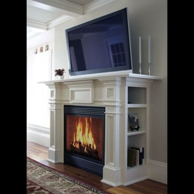 Faux fireplace with bookshelves on sides. Want to build this. :)