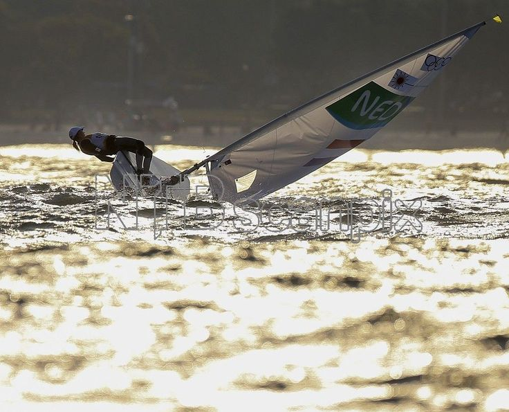 Marit Bouwmeester of the Netherlands tries to sail in heavy wind ahead of the postponed women's Laser Radial medal race of the Rio 2016 Olympic Games Sailing events at Guanabara Bay in Rio de Janeiro, Brazil, 15 August 2016. After a windless morning, strong breeze in the afternoon forced the cancellation of all races. EPA/OLIVIER HOSLET