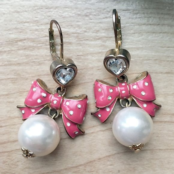 Betsey Johnson Bow and Pearl Drop Earrings Betsey Johnson Pink polka-dot bow earrings, with faux pearl accents. Gold plating and a heart shaped crystal polish off these adorable drop earrings! Betsey Johnson Jewelry Earrings