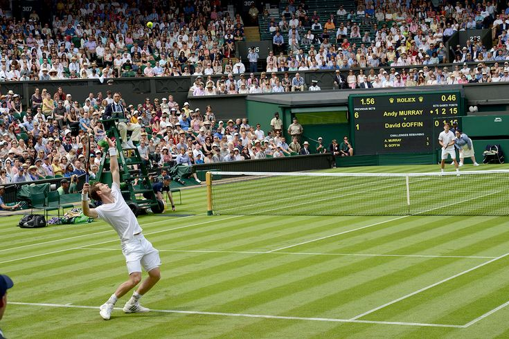 Andy Murray serves to David Goffin during their First round match - Jon Buckle/AELTC