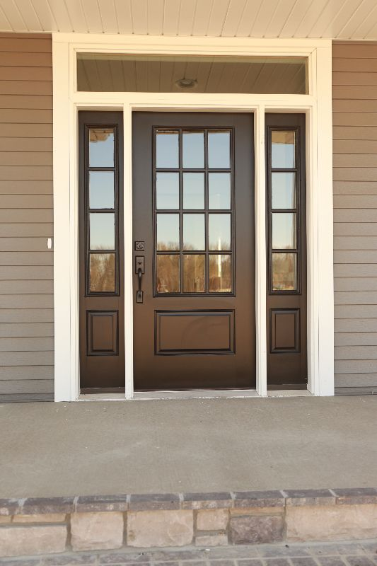Exterior Doors | what could be better than a bright, shiny, new door on a bright, shiny spring day?  fiberglass fir door with 12 lites and matching sidelites in an Acclimated Entry System | Bayer Built Woodworks, Inc.