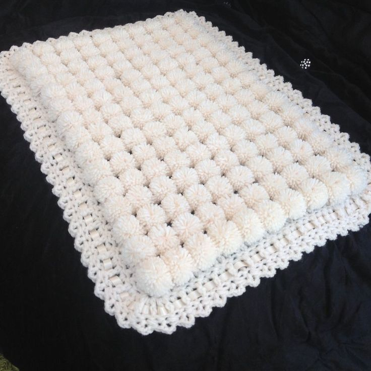 Beautiful Cream Pom Pom Blanket. Pram Size