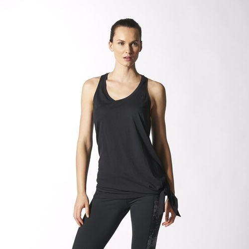 Baila con libertad con la camiseta sin mangas Studio Culture de #Adidas. Tiene un corte largo asimétrico que te permitirá moverte fluidamente que puedes anudar o enrollar a la cintura.