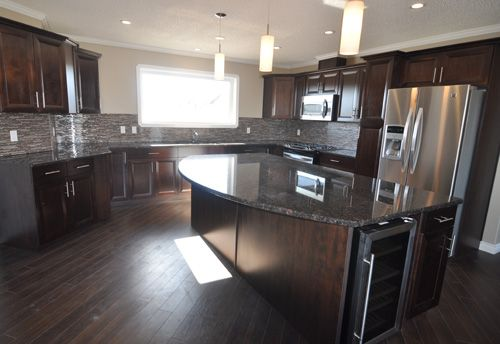 Jandel Homes | The Riverside | RTM complete with granite counter tops and stainless steel appliances