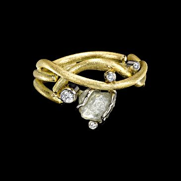 Ring of 18ct yellow gold set with rough and brilliant cut diamonds
